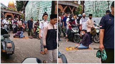 Viral Video Pria Salat di Tengah Jalan, Aksi Warga SekitarJadi Sorotan