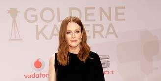 Aktris asal Amerika Serikat, Julianne Moore dikabarkan akan berperan sebagai penjahat di film 'Kingsman 2'. Jika ia benar bergabung, Julianne Moore akan mengambil peran yang sebelumnya dimainkan oleh Samuel L. Jackson. (AFP/Bintang.com)