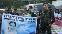 Filipina protes atas pembunuhan pekerja bernama  Joanna Demafelis di Kuwait. Tubuhnya dibuang ke freezer oleh pasangan Lebanon dan Suriah (AFP)