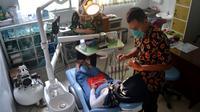 Pemeriksaan gigi ibu hamil di Puskesmas Kebasen, Banyumas. (Foto: Liputan6.com/Muhamad Ridlo)