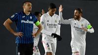 Real Madrid meraih kemenangan 3-1 atas Atalanta pada laga leg kedua 16 besar Liga Champions di Estadio Alfredo Di Stefano, Rabu (17/3/2021) dini hari WIB. Berkat hasil ini, Madrid lolos ke perempat final dengan agregat 3-0. (AFP/PIERRE-PHILIPPE MARCOU)