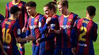 Barcelona meraih kemenangan 4-0 atas Osasuna pada laga lanjutan pekan ke-11 La Liga 2020-2021 di Camp Nou, Minggu (29/11/2020) malam WIB. (AFP/Lluis Gene)