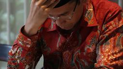 Ekspresi mantan Gubernur NTB Tuan Guru Bajang (TGB) Muhammad Zainul Majdi saat konferensi pers di Jakarta, Rabu (19/9). Berdasarkan dokumen yang diperoleh salah satu media, TGB diduga menerima gratifikasi berjumlah Rp 7,36 M. (Merdeka.com/Imam Buhori)