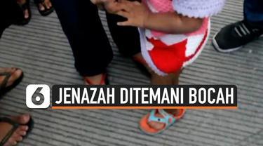 Warga Makassar Sulawesi Selatan dihebohkan penemuan jenazah perempuan yang ditemani anak kandungnya. Anak tersebut baru berusia 2 tahun.