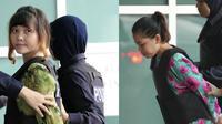 (kanan) Don Thi Huang dan (kiri) Siti Aisyah menuju laboratorium di Kuala Lumpur, Malaysia untuk pengecekan racun VX Nerve Agent yang digunakan untuk membunuh Kim Jong-nam. (AP Photo/Vincent Thian)