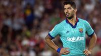 Luis Suarez lesu melihat Barcelona kalah di kandang (AFP)