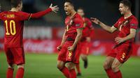Youri Tielemans dari Belgia merayakan setelah mencetak gol pembuka selama pertandingan sepak bola UEFA Nations League antara Belgia dan Denmark di stadion King Power di Leuven, Belgia, Rabu, 18 November 2020. (AP Photo / Francisco Seco)