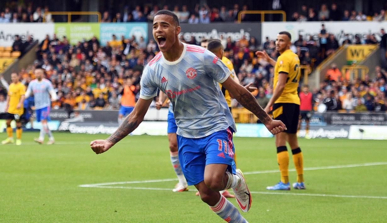 Manchester United sukses membawa poin tiga di pekan ketiga Liga Inggris 2021/2022, dari lawatannya ke markas Wolverhampton. Skuat asuhan Solskjaer tersebut memenangkan laga dengan skor tipis 1-0. (Foto: AFP/ Oli Scarff)