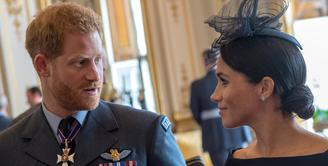 Pangeran Harry benar-benar mencintai Meghan Markle. Meski ia ingin miliki anak, namun Pangeran Harry tak ingin terburu-buru. (CHRIS J RATCLIFFE / POOL / AFP)