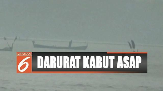 Kabut asap Riau meluas ke Perairan Belawan, Medan, Sumatra Utara karena terbawa angin.