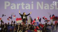 Ketum Partai Nasdem, Surya Paloh memberi pidato saat Rapat Kerja Nasional (Rakernas) IV Partai Nasdem di JIExpo Kemayoran, Jakarta Pusat, Rabu (15/11). Acara ini juga sekaligus sebagai peringatan HUT ke-6 Partai Nasdem. (Liputan6.com/Faizal Fanani)