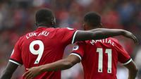 Winger Manchester United (MU), Anthony Martial, tampil baik di awal 2017/2018 berkat kontribusi Romelu Lukaku. (AP Photo/Dave Thompson)