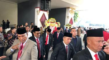 Mantan Gubernur DKI Djarot Saiful Hidayat sebelum pelantikan anggota DPR. (Liputan6.com/Delvira Hutabarat)