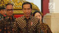 Presiden Joko Widodo tiba untuk memberikan arahan kepada dalam rangka Jambore Sumber Daya Program Keluarga Harapan (PKH) di Istana Negara, Jakarta, Kamis (13/12). Jambore diikuti 598 peserta dari seluruh Indonesia. (Liputan6.com/Angga Yuniar)