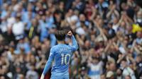 Gelandang Manchester City merayakan gol ke gawang Norwich City pada laga Liga Inggris 2021/2022 di Etihad Stadium, Sabtu (21/8/2021). (AFP/Adrian Dennis)