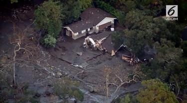 Longsor dipicu hujan deras menghancurkan sebagian rumah di Montecito, California.