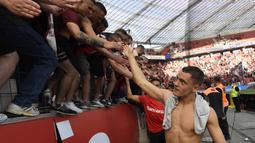 Florian Wirtz. Gelandang serang Leverkusen berusia 18 tahun ini mencetak gol tunggal kemenangan 1-0 atas Mainz. Gol tersebut adalah gol ke-10 nya bersama Leverkusen sejak 2019/2020 dan mematahkan rekor Lukas Podolski sebagai pemain termuda dengan koleksi 10 gol di Bundesliga. (AFP/Roberto Pfeil)