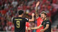 Bayern Munchen menang 4-0 atas Benfica pada laga ketiga Grup F Liga Champions di Estadio da Luz, Kamis (21/10/2021) dini hari WIB. (AFP/PATRICIA DE MELO MOREIRA)