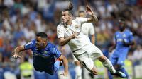 Gareth Bale (kanan) saat beraksi untuk Real Madrid lawan Getafe (AP Photo/Andrea Comas)