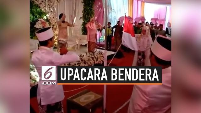 Viral video pasangan pengantin yang melakukan upacara bendara di acara pernikahan mereka.