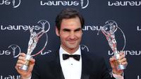 Roger Federer meraih dua penghargaan di ajang Laureus World Sports Awards 2018, yakni Sportsman of the Year dan Comeback of the Year. (AFP/Valery Hache)