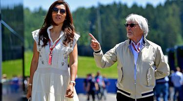 Mantan bos F1, Bernie Ecclestone dan sang istri, Fabiana Flosi. (ANDREJ ISAKOVIC / AFP)