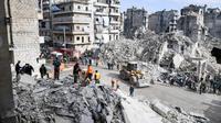 Kompleks bangunan apartemen sisa perang Suriah di Aleppo roboh, menyebabkan 11 orang tewas (AFP/George Ourfalian)