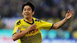 2. Shinji Kagawa - Pemain asal Jepang itu menjelma menjadi pemain bintang saat berseragam Borussia Dortmund. Kagawa berhasil membawa Dortmund meraih gelar Bundesliga dua kali beruntun yaitu pada musim 2010-2011 dan 2011-2012. (AFP/Patrik Stollarz)