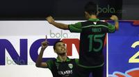 Ekspresi pemain Vamos, Ilham Ramadhyan, setelah mencetak gol ke gawang Antam dalam laga Seri III Grup B Wilayah Timur Pro Futsal League 2016 di GOR 17 Desember, Mataram, NTB, Minggu (13/3/2016). Vamos Mataram menang 12-6. (Bola.com/Arief Bagus)