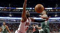 Dwayne Wade (kiri) rela meninggalkan Miami Heat untuk bergabung dengan Chicago Bulls. (AP Photo/Charles Rex Arbogast)