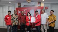 Mantan Wakapolda Jawa Tengah (Jateng) Brigjen Pol (Purn) Awang Anwarudin (kiri dari tengah) menjadi calon legislatif melalui Partai Solidaritas Indonesia (PSI). (Istimewa)