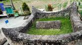 Penampakan makam Raja Bulonggodu atau Blongkod di Desa Dunggala, Tapa, Bone Bolango, Gorontalo, Sabtu (18/5/2019). Makam Raja Bulonggodu menyimpan misteri kehidupan masa lalu Gorontalo. (Liputan6.com/Arfandi Ibrahim)