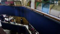 Sejumlah kios Blok G Pasar Tanah Abang terlihat tutup, Jakarta, Rabu (7/3). Sebelum dirobohkan, Pemerintah Provinsi DKI harus memastikan terlebih dulu relokasi pedagang di Blok G Pasar Tanah Abang sudah bisa dilakukan. (Liputan6.com/Johan Tallo)