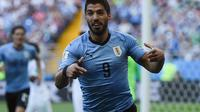 Uruguay dipastikan lolos ke babak 16 besar Piala Dunia 2018 setelah mengalakan Arab Saudi dengan skor 1-0 berkat gol Luis Suarez. (AFP/Khaled Desouki)