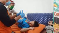 Khitan anak berkebutuhan Khusus. Foto: dokumentasi Y-AMI