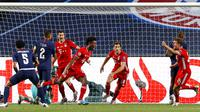 Pemain Bayern Munchen, Kingsley Coman, melakukan selebrasi usai mencetak gol ke gawang Paris Saint-Germain (PSG) pada laga final Liga Champions di Stadion The Luz, Portugal, Senin (24/8/2020). Bayern Munchen menang 1-0 atas PSG. (Matthew Childs/Pool via AP)