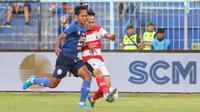 Madura United kalah 0-2 dari Arema FC dalam lanjutan Shopee Liga 1 2019 di Stadion Kanjuruhan, Kab. Malang, Jumat (8/11/2019). (Bola.com/Aditya Wany)