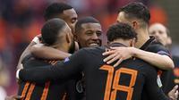 Kemenangan 3-0 Belanda atas Makedonia Utara dalam laga terakhir Grup C Euro 2020 (Euro 2021), Senin (21/6/2021) selain memastikan tersingkirnya Makedonia Utara dan lolosnya Belanda ke 16 Besar dengan poin sempurna, juga memuat 4 fakta menarik. Apa saja? (Foto: AP/Pool/Kenzo Tribouillard)