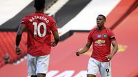 Anthony Martial merayakan golnya saat MU melawan Sheffield United di Liga Inggris (AP)