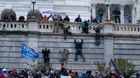 Gedung Capitol Hill AS diserbu massa pendukung Donald Trump. (Jose Luis Magana/AP)