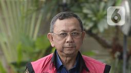 Mantan Dirut PT Asuransi Jiwasraya, Hendrisman Rahim akan menjalani pemeriksaan dari Kejaksaan Agung di Gedung KPK, Jakarta, Senin (20/1/2020). Hendrisman diperiksa sebagai tersangka terkait kasus korupsi PT Asuransi Jiwasraya diperkirakan kerugian negara Rp 13,7 triliun. (merdeka.com/Dwi Narwoko)