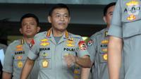 Kapolri Jenderal Idham Azis (tengah) meninggalkan Gedung KPK usai menggelar pertemuan tertutup, Jakarta, Senin (4/11/2019). Pertemuan membahas sinkronisasi antara Kepolisian dengan KPK. (merdeka.com/Dwi Narwoko)