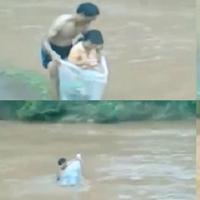 Seorang bapak rela tenggelam asal anaknya selamat menyebrangi sungai dalam dan deras. (Sumber Foto: Kapanlagi.com)