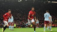 Selebrasi pemain MU Marcus Rashford saat melawan Aston Villa (AFP)