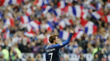 Penyerang Prancis, Antoine Griezmann, melakukan selebrasi usai membobol gawang Jerman pada laga UEFA Nations League di Stade de France, Paris, Selasa (16/10/2018). Prancis menang 2-1 atas Jerman. (AP/Christophe Ena)