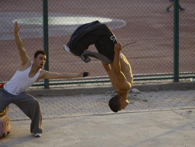 Parkour mulai diminati para pemuda Irak, Rabu (14/05/2014) (AFP PHOTO/HAIDER HAMDANI).