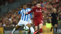 Andrew Robertson ciptakan dua assist saat Liverpool pesta gol lawan Huddersfield Town, Sabtu (27/4/2019) (AFP)