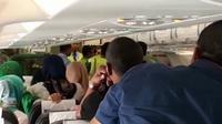 Akibat cekcok antara penumpang dan pramugari, pesawat Citilink yang semestinya lepas landas pukul 09.35 WIB, baru terbang sejam kemudian. (Liputan6.com/Reza Efendi)