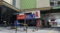 Suasana Gedung Blok A Pasar Tanah Abang, Jakarta, Rabu (22/5/2019). Dampak kericuhan di sekitar Pasar Tanah Abang yang berlangsung sejak dini hari, aktivitas perdagangan di kawasan tersebut lumpuh total. (merdeka.com/Iqbal S Nugroho)