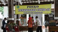 Posko penangan COVID-19 di Kabupaten Sidoarjo, Jawa Timur. (Foto: Liputan6.com/Dian Kurniawan)